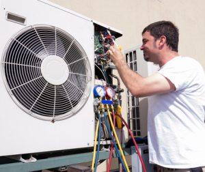 Man working on HVAC unit