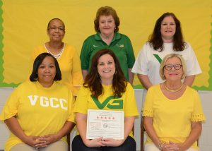 The staff of the Vance-Granville Community College Child Care Center (on the college's Main Campus) proudly display the certificate indicating the center's renewed five-star license. They include, seated, from left, Pam Harris, Melanie Copeland and Kathy Hughes; and standing, from left, Hilda Cordell, Anita Fuller, and Rhonda Pegram.