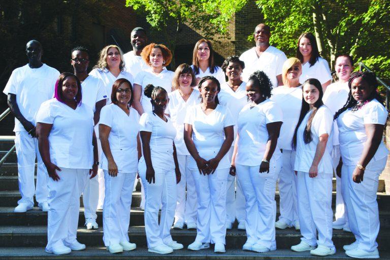 Group of Nurses on campus steps