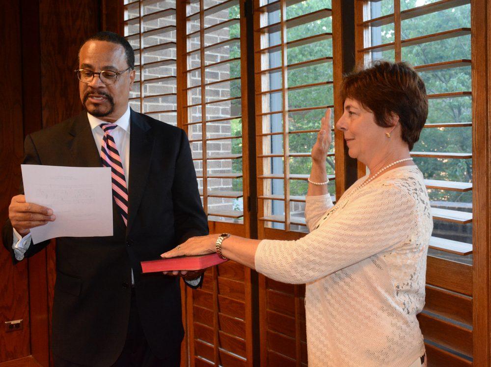new women board member being sworn in