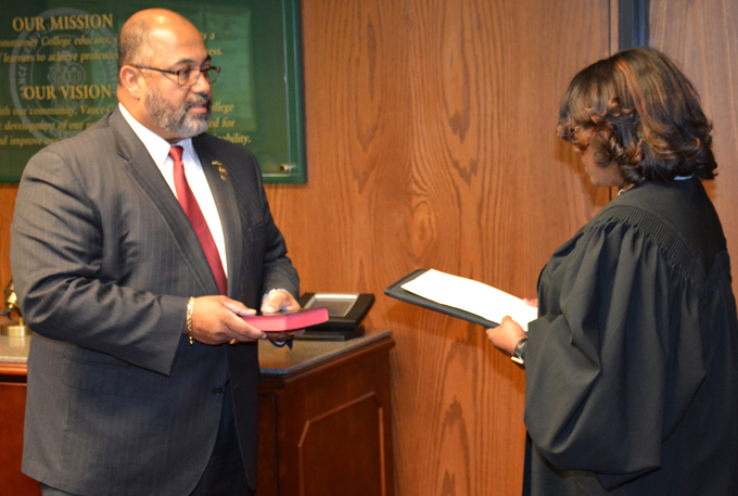 Xavier Wortham of Oxford, left, is sworn in as a newly appointed member of the VGCC Board of Trustees by Ninth Judicial District Court Judge Carolyn J. Thompson at the board's meeting on Nov. 20.