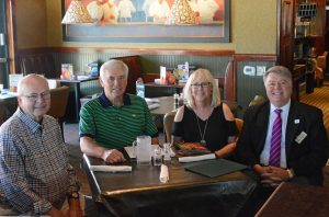 Eddie Ferguson sits with friends to discuss scholoarship plans
