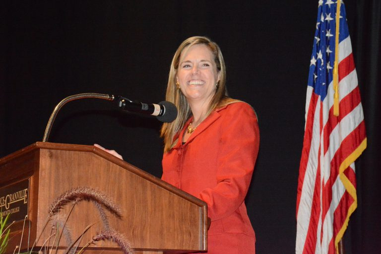 Tanya Evans speaking from podium