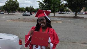 Oneisha Rebecca Leonard holding degree