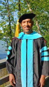 Dr. Jerry Edmonds in his doctoral regalia.
