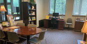 photo of the career center with book shelf, table and computer workstation