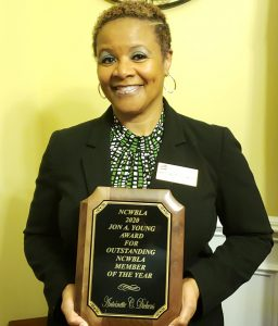 Antoinette Dickens holding a plaque