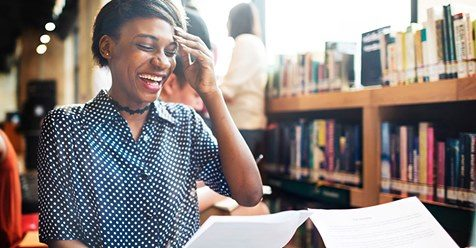 Young women laughing in the library