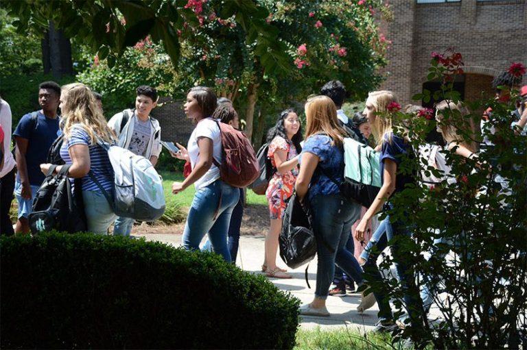 students between classes walking